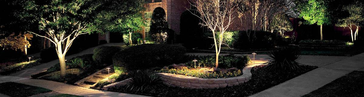 Home exterior security lighting outside of a large home.