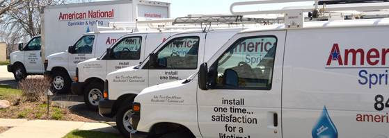 Fleet of vans ready to install a commercial sprinkler syste,m.