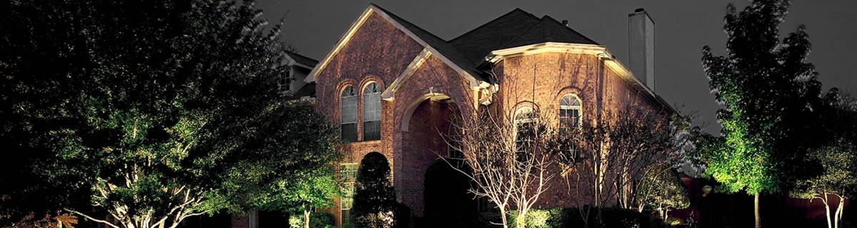 A large home with an outdoor lighting installation.