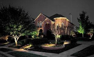 Large house with outdoor lighting.