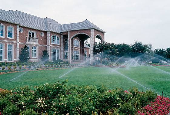 Large house with residential sprinkler system from a lawn irrigation company.