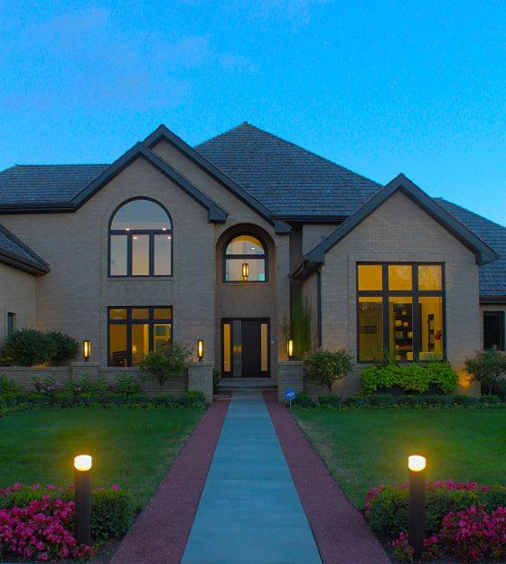 A house with Northbrook landscape lighting in the front of the house..