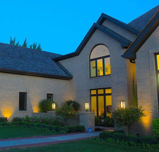 This is the front of a house with Northbrook landscape lighting.