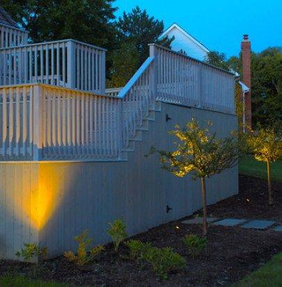 The side of a house with great Chicago landscape lighting.