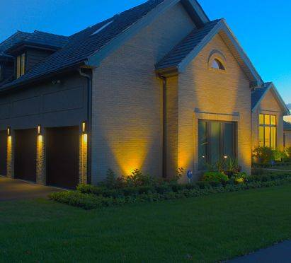 Chicago landscape lighting on a house completed by American National.