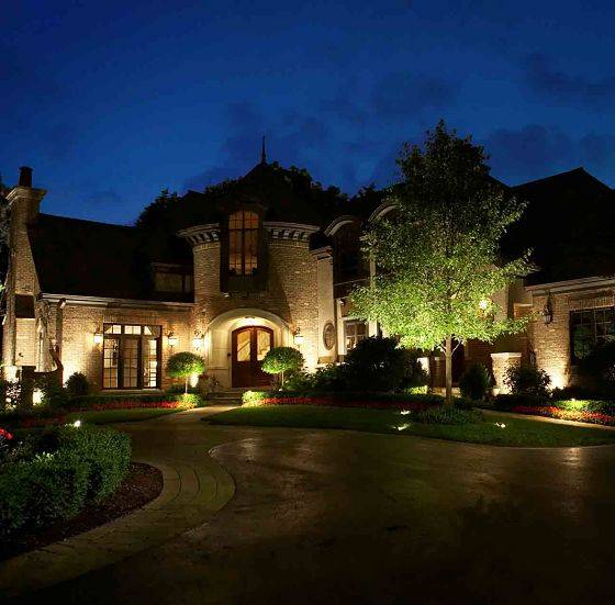Large house with lighting system from outdoor lighting professional American National.