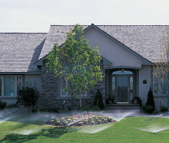 A house with in ground sprinklers from a yard irrigation company American National.