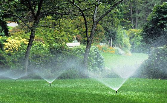 An underground sprinkler system watering a large property.
