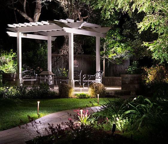 A landscape lighting installation company, American National, set up backyard lights.