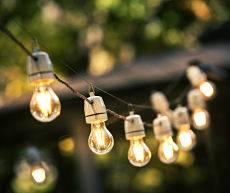 Artistic outdoor lighting - stringer lights outside.