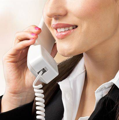 Outdoor lighting company customer service woman helping clients on the phone.