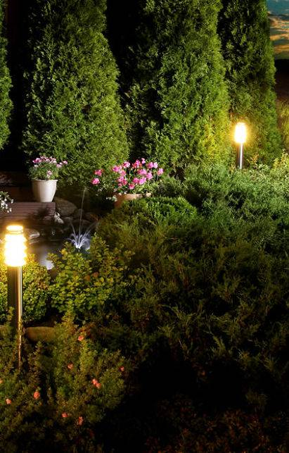 Beautiful outdoor lighting - two garden lights illuminating the garden.