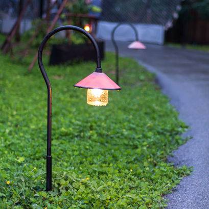 Outdoor accent lighting can brighten up a pathway.