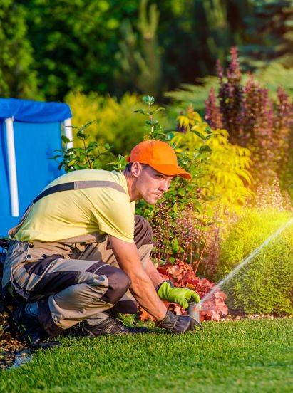 A sprinkler system technician working on sprinkler system winterization.
