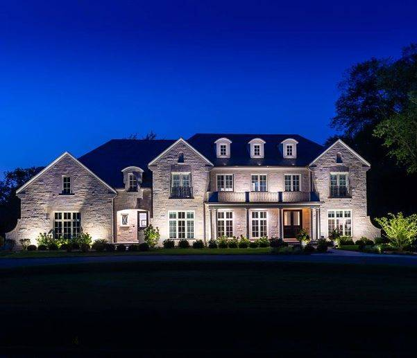 Home exterior lighting on a house done by American National Sprinkler & Lighting.