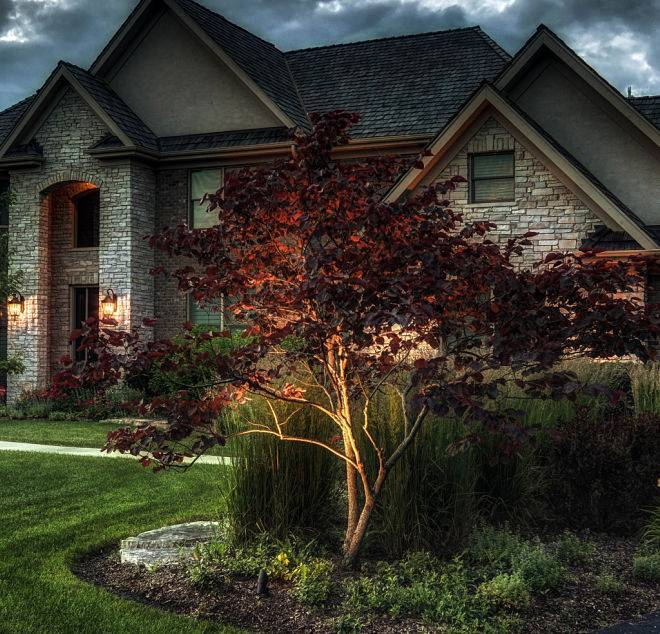 Automatic home exterior lighting system installed by American National Sprinkler & Lighting.