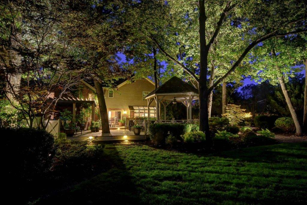 American National Sprinkler & Lighting - automatic lighting system on backyard of customer's house.