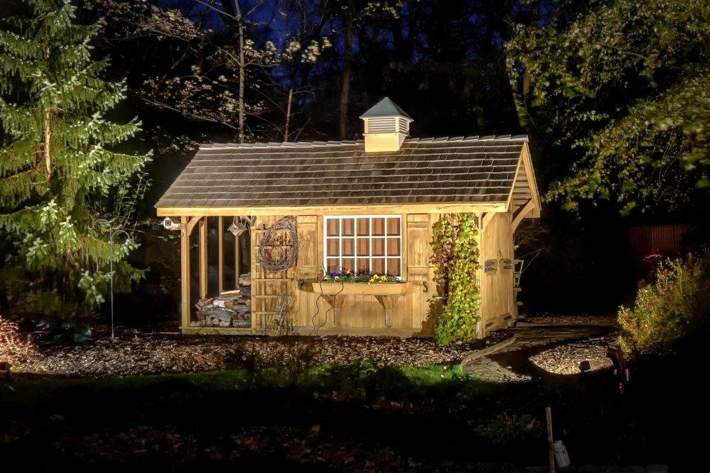 American National Sprinkler & Lighting - automatic lighting system illuminating shed in the backyard.