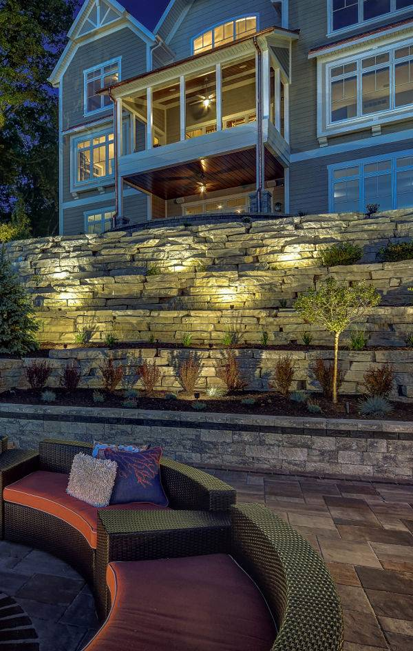American National Sprinkler & Lighting - outdoor lighting contractor added automatic lighting system to this outdoor living area.