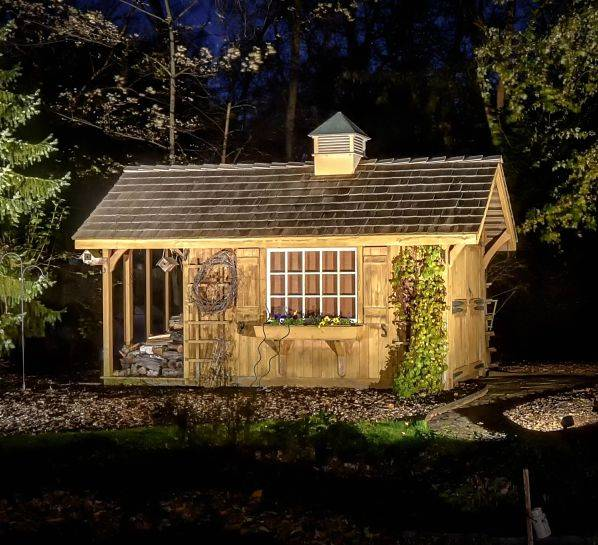 American National Sprinkler & Lighting - this Highland Park home has Highland Park landscape lighting in their backyard highlighting a decorative shed.
