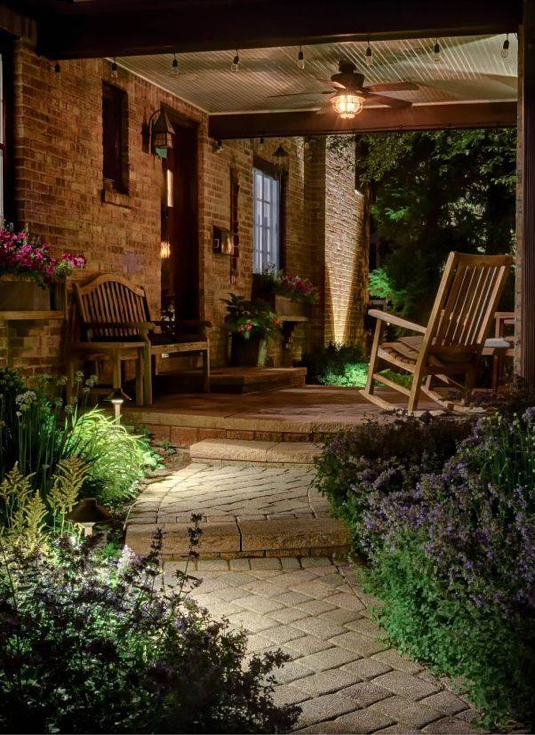 American National Sprinkler & Lighting - this pathway to a Highland Park home has Highland Park landscape lighting in the front.