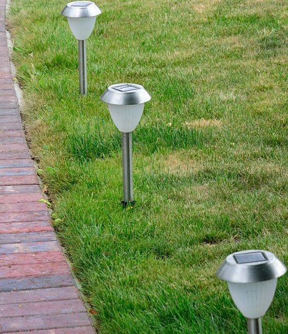 American National Sprinkler & Lighting - we offer landscape lighting repair for current American National customers only - lighting fixtures along a pathway.