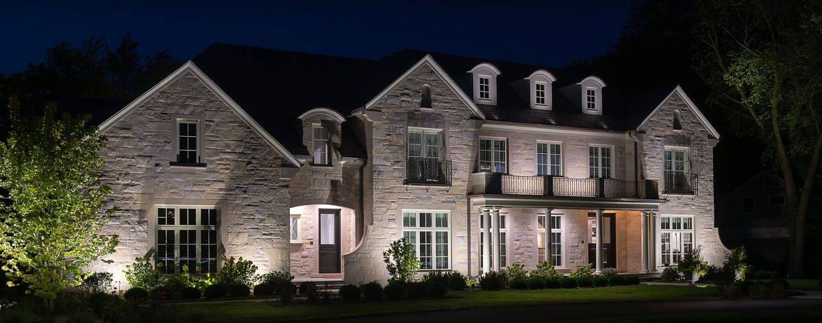 American National Sprinkler & Lighting - a home in Northfield, IL with an outdoor sprinkler system and landscape lighting.