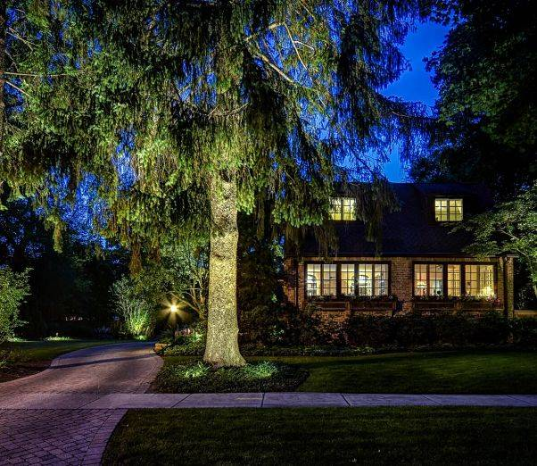 American National Sprinkler & Lighting - a home in Libertyville, IL with an outdoor landscape lighting and driveway lighting.