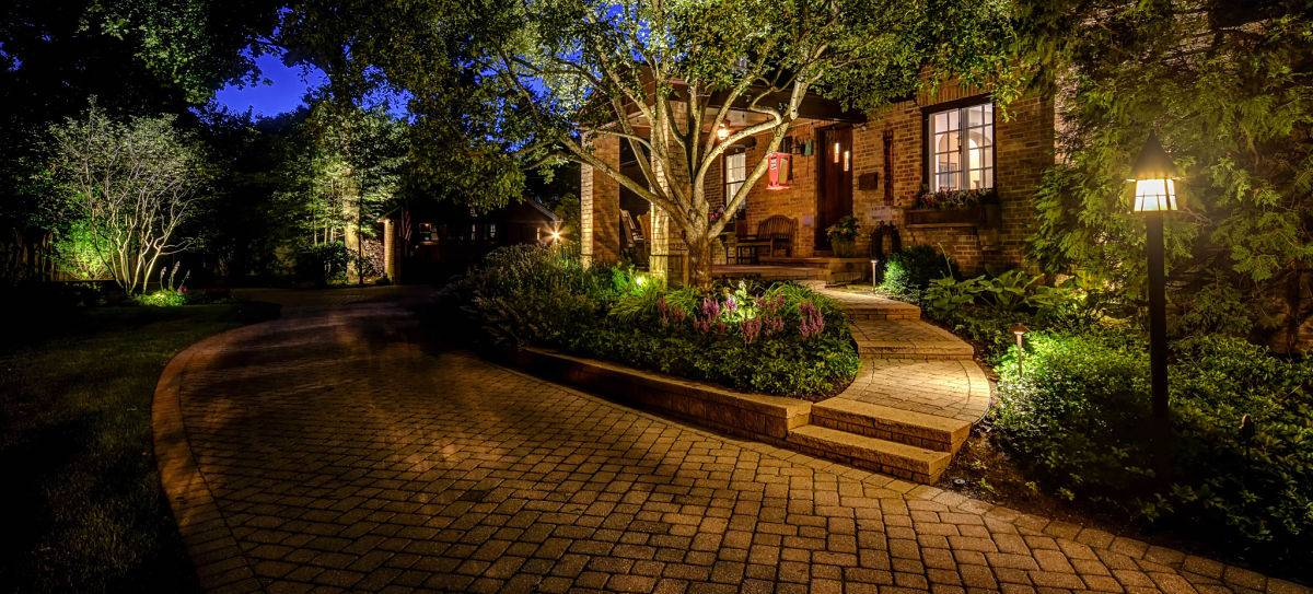 American National Sprinkler & Lighting - a home in Libertyville, IL with an outdoor landscape lighting..