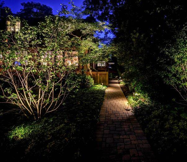 American National Sprinkler & Lighting - a home in Libertyville, IL with an outdoor landscape lighting and pathway lighting.