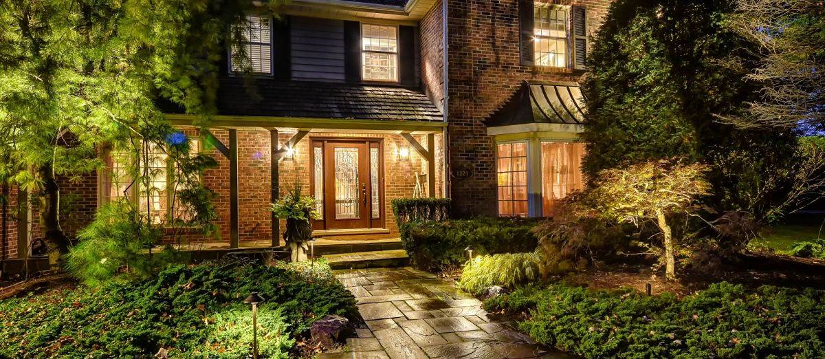 American National Sprinkler & Lighting - a home in Northbrook, IL with an outdoor landscape lighting in the front of the home.