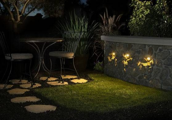 Custome outdoor lighting on a bar area at night.